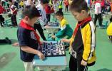 系列活动比拼棋艺 校园童棋节趣味多