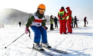 People enjoy skiing across China