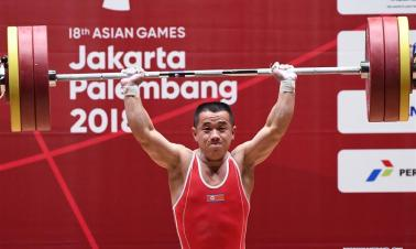 Om Yun Chol of DPRK wins men's weightlifting 56kg event at 18th Asian Games